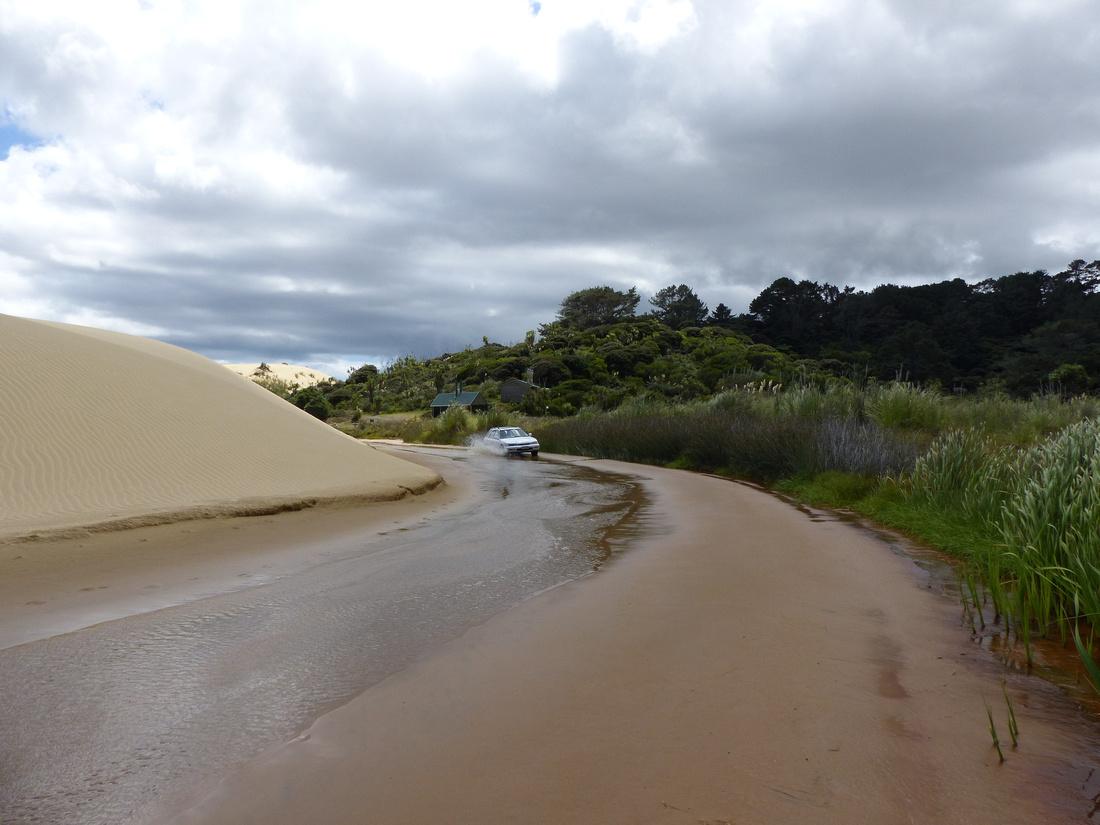 tra-NZ-northland-driving_in_te_paki_stream-1